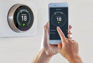Smart Thermostat With A Person Saving Energy