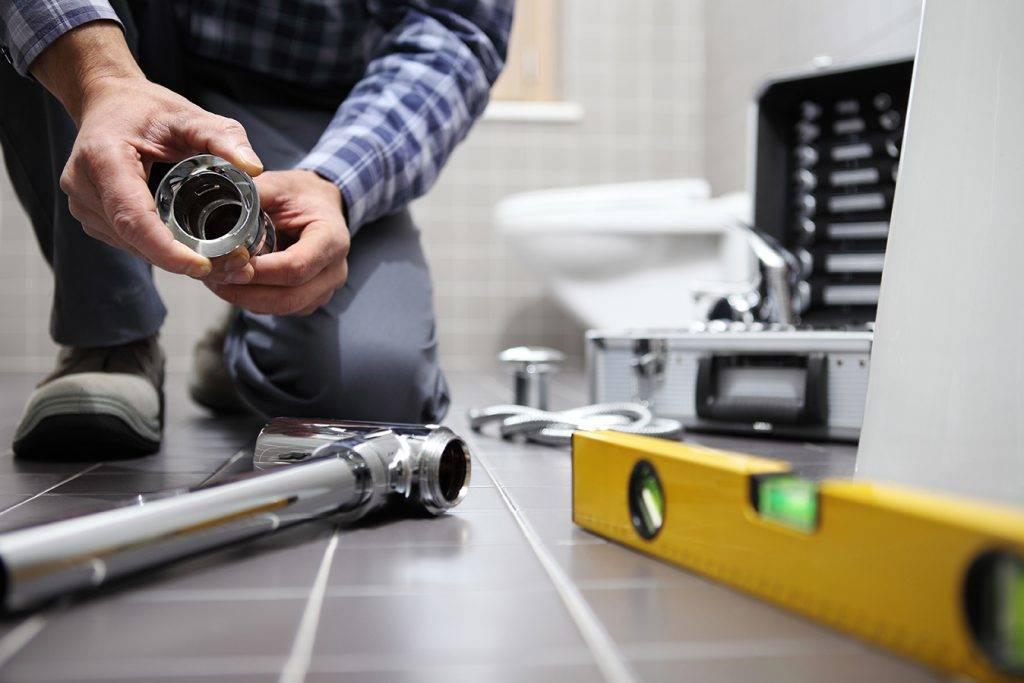 Plumber At Work Installing A Bathroom 2