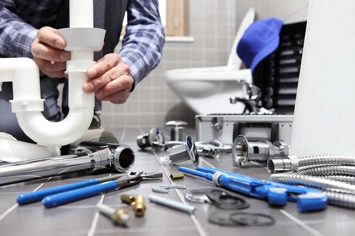 Plumber At Work Installing A Bathroom