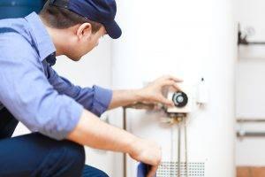 Plumber Repairing Hot Water Heater