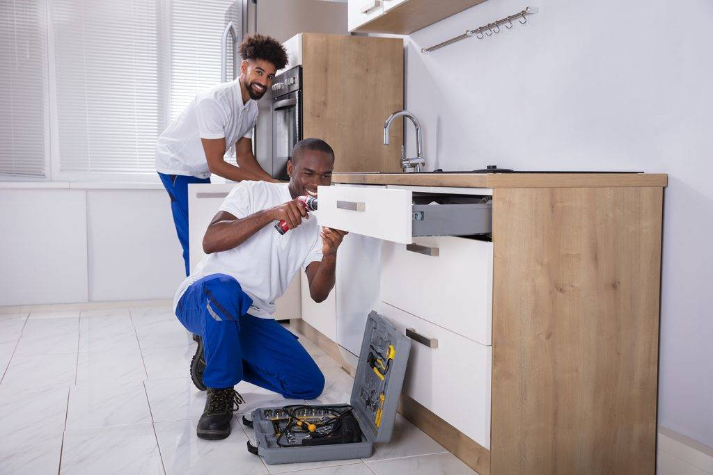 Two Plumbers Installing Kitchen